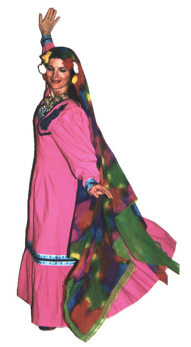 Chelydra in a pink and turquoise fellahin dress and multicolored head veil.